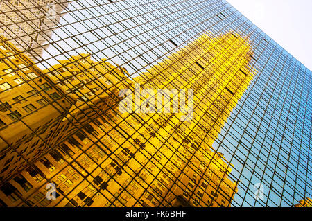 The Chrysler Building reflected in modern glass skyscraper, Lexington Avenue, New York, United States of America, - Stock Photo