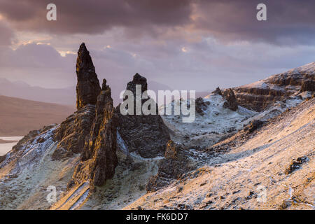 Snow dusted Old Man of Storr at sunrise, Isle of Skye, Inner Hebrides, Scotland, United Kingdom, Europe - Stock Photo