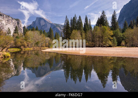 Half Dome reflected in the still waters of the Merced River, Yosemite Valley, UNESCO, California, United States - Stock Photo