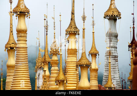 Golden pagodas at the Nyaung Oak monastery in Indein, the largest and oldest monastery on Inle Lake, Shan state, - Stock Photo