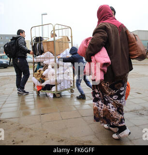Halberstadt, Germany. 7th Mar, 2016. Refugees arriving at the new arrival centre for asylum seekers at the Central - Stock Photo