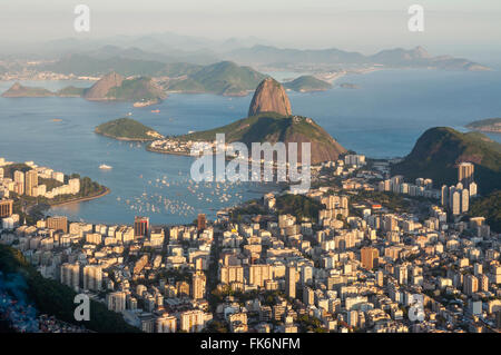 Late evening view over Rio de Janeiro from the Christ the Redeemer statue on top of Corcovado mountain. Favela in - Stock Photo