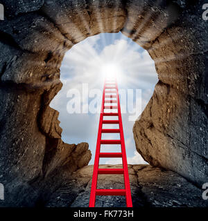 Concept of open mind as a a deep mountain cliff shaped as a human head with a ladder leading to the outside towards - Stock Photo