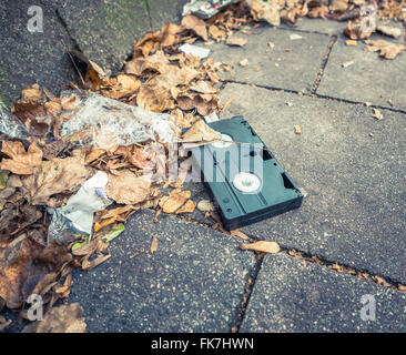 Conceptual Image Of An Abandoned VHS Tape In The Street - Stock Photo