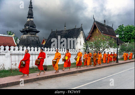Asia. South-East Asia. Laos. Province of Luang Prabang, city of Luang Prabang, Lao buddhist monks collecting alms. - Stock Photo
