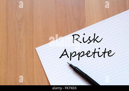 Risk appetite text concept write on notebook with pen - Stock Photo