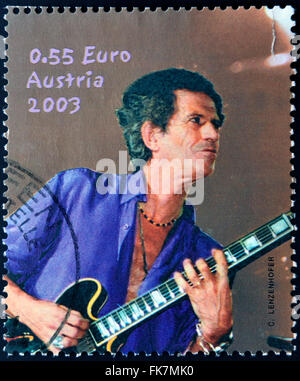 AUSTRIA - CIRCA 2003: A stamp printed in Austria shows image of famous English musician, composer, singer Keith - Stock Photo