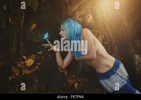 Beautiful butterfly hunter . Fantasy and fairy - Stock Photo