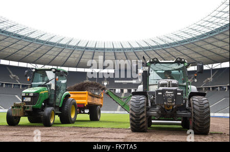 Berlin, Germany. 7th Mar, 2016. The old turf getting cut before the 8,000 square meters are exchanged for new turf - Stock Photo