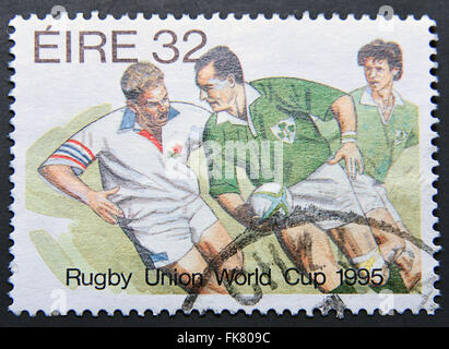 IRELAND - CIRCA 1995: A postage stamp shows Rugby Union World Cup 1995 - Stock Photo