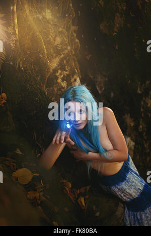 Beautiful woman in magical forest hunting butterflies . Fantasy and fairy - Stock Photo