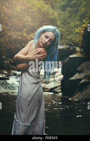 Romantic portrait of a young woman in the stream waters. Purity conceptual - Stock Photo