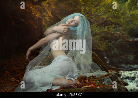 Romantic portrait of beautiful woman in autumn colors forest . Dreamy and ethereal - Stock Photo