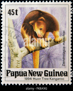 PAPUA NEW GUINEA - CIRCA 1994: A stamp printed in Papua shows a Huon Tree Kangaroo (dendrolagus matschiei), circa - Stock Photo