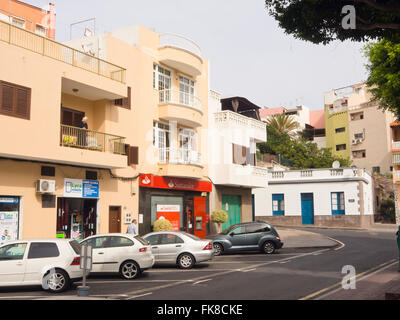 Row of houses, parked cars, Santander bank in the central plaza of Alcala, Tenerife Canary Islands Spain - Stock Photo