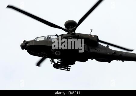 AgustaWestland Apache attack helicopter from RAF Wattisham over Rendlesham forest Suffolk UK - Stock Photo