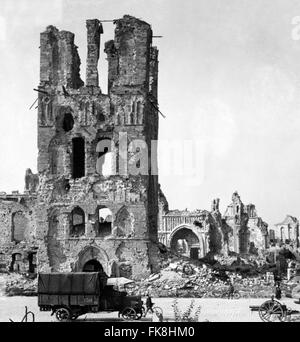 Ruins of the cathedral at Ypres with a British army truck in the foreground, Flanders, Belgium in World War I. Photo - Stock Photo