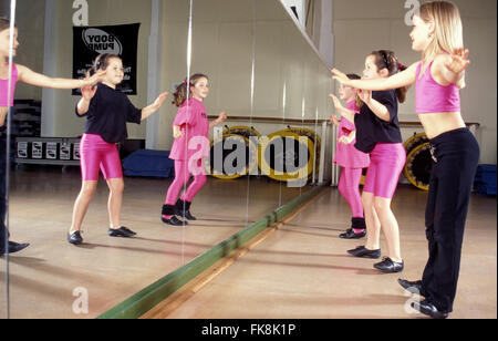Children exercising in a gym - Stock Photo