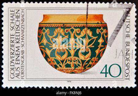 GERMANY - CIRCA 1976: A stamp printed in Germany shows Archaeological Heritage, Gold-ornamental bowl, circa 1976 - Stock Photo