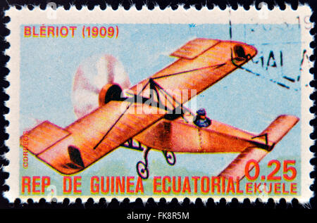 EQUATORIAL GUINEA - CIRCA 1974: A stamp printed in Guinea dedicated to history of aviation shows Blériot XI, 1909, - Stock Photo
