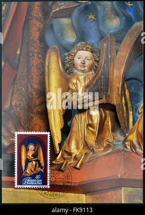 LIECHTENSTEIN - CIRCA 1982: A stamp printed in Liechtenstein dedicated to Sculptures from Chur Cathedral shows Angel - Stock Photo