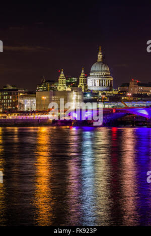 St Paul's cathedral over Blackfriars Bridge and Thames river at night with lights reflecting in the water. - Stock Photo