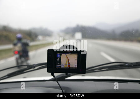 Global Positioning System - GPS car indicating way to Castelo Branco highway - Stock Photo