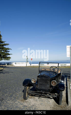 Old car in the historic center of Colonia de Sacramento in Uruguay - Stock Photo