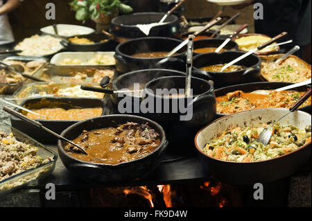 Wood stove with typical local food. - Stock Photo