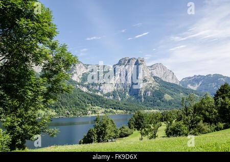 The Grundlsee vacation region is one big natural playground: the Grundlsee invites you to swim and relax. - Stock Photo