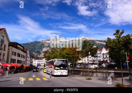 Tourist Bus in a Street of the Swiss Town of Chur (Canton of Graubünden, Eastern Switzerland) on a Fine Day - Stock Photo