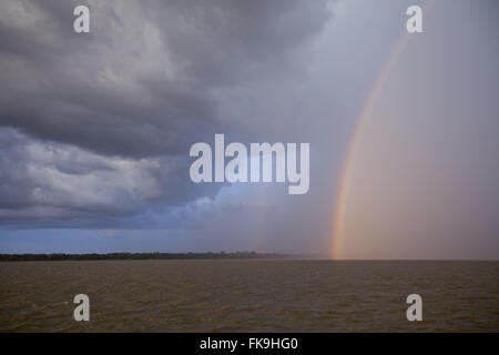 Tropical rain and bow in the region of Alto Solimoes - Stock Photo