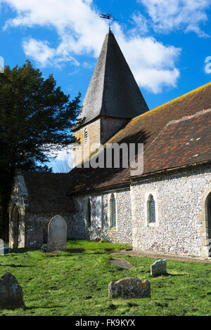 The Norman church of St Peter in the village of Rodmell in early spring, East Sussex, England, UK - Stock Photo