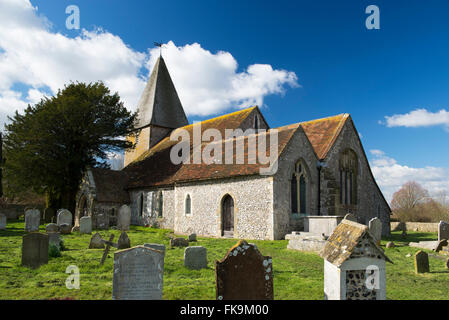 The Norman church of St Peter in the East Sussex village of Rodmell in early spring - Stock Photo
