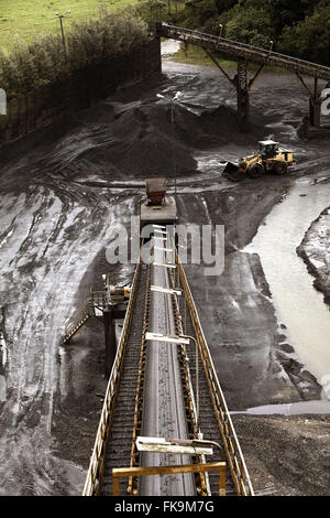 Conveyor for coal and coal pa loader moving the patio - Stock Photo
