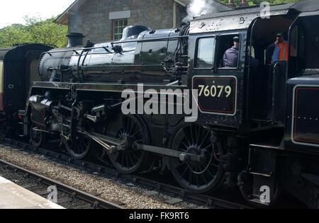 Steam locomotive 76079 showing engine driver waiting at Levisham sation on the North York Moors Heritage Railway - Stock Photo
