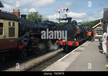 Pair of steam trains, 49395 and 76079 at Levisham Station on the North York Moors Heritage Railway - Stock Photo