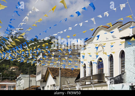 Street decorated with flags for the traditional Feast of Saint Benedict - Stock Photo
