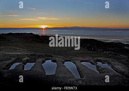 St Patricks Chapel, Heysham, UK. 7th March, 2016.   Sunset from St Patricks Chapel over looking the water filled - Stock Photo