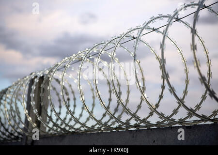 Fence with barbed wire in a secure area of the wind farm Source of the Winds - Stock Photo