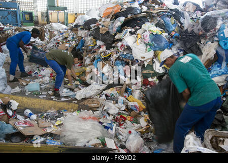Treadmill for separation of recyclable materials - Stock Photo