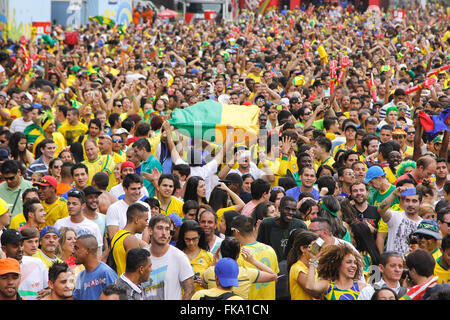 Selection of Brazilian fans celebrate victory at Fan Fest in Valley Anhangabau - Stock Photo