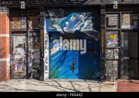 graffiti covered artist studio in the Lower East Side of New York City - Stock Photo