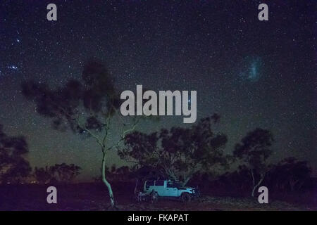 camping under the night sky over the Pilbarra, Western Australia - Stock Photo