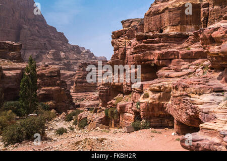 Rock formations in the carved red rock city of Petra, Hashemite Kingdom of Jordan. - Stock Photo