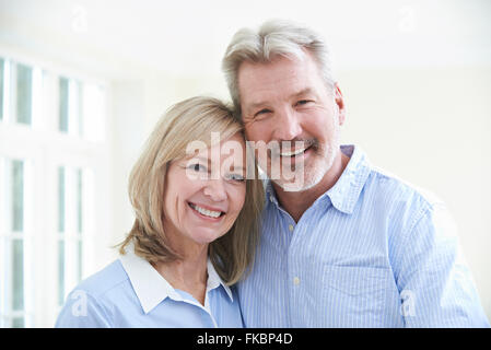 Portrait Of Loving Mature Couple At Home - Stock Photo