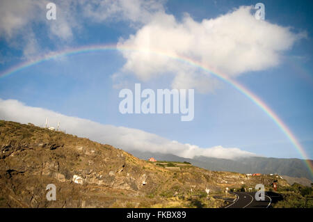 rainbow rainbows water refraction retracted light index complete arch arches light splitting in to separate wavelengths - Stock Photo