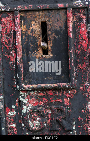 snail mail,british, broken, communication, day, decommissioned, drystone, GR. faded, letter, letterbox, lock, mail, - Stock Photo