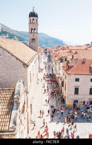 Crowds of holiday makers enjoy the sun and sightseeing around the old historical city of Dubrovnik in Croatia. - Stock Photo
