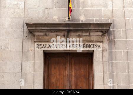 Ancient Hospital de la Santa Creu, door sign Real Academia de Medicina,El Raval, Barcelona. - Stock Photo